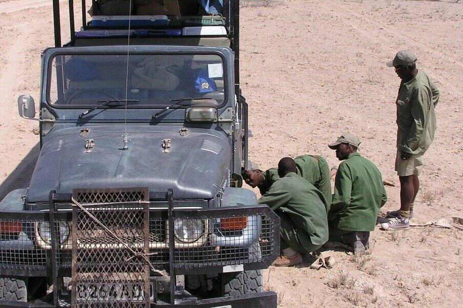 Roadside repairs as we leave the Kahahari Desert in Botswana - ExplorationVacation