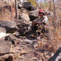man sitting on a trail