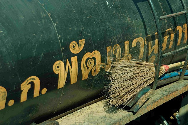 decorative writing on a tanker truck