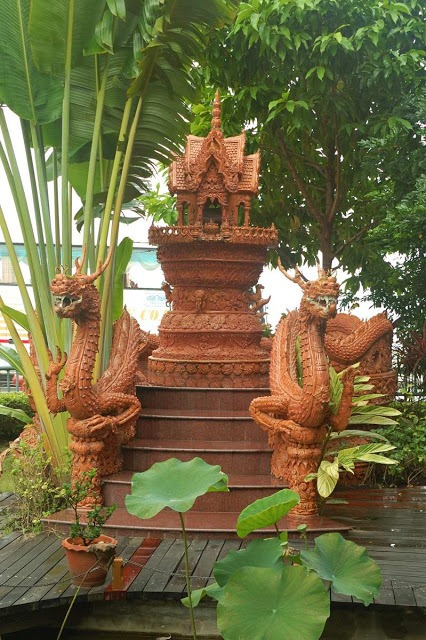 small shrine in a Thai garden