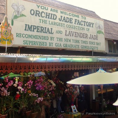 outside of Jade factory with sign and orchid