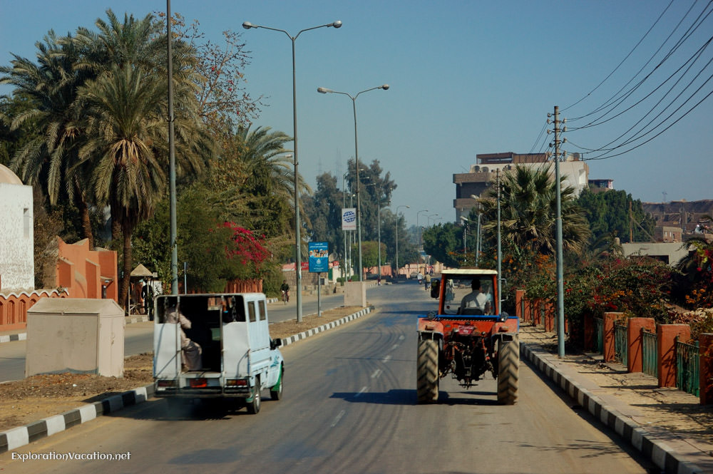 almost empty street with a truck and a tractor