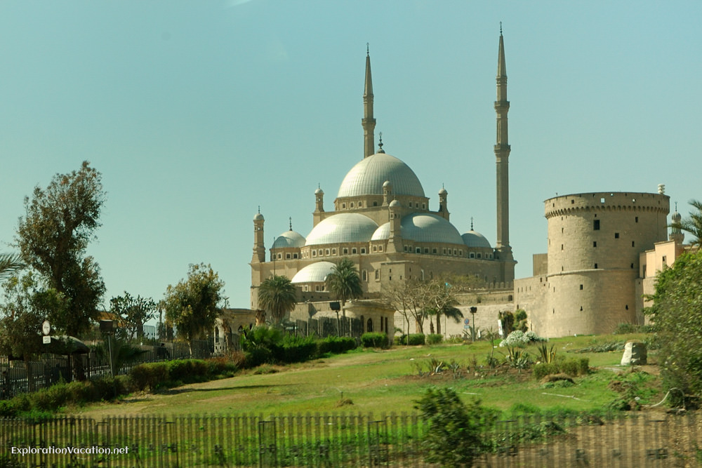 large mosque with multiple domes on a hill
