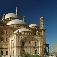 mosque with multiple domes and minarets