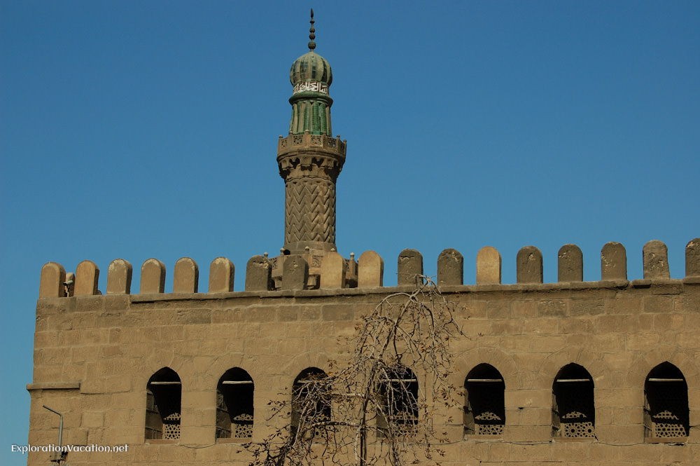 minaret above a crenelated wall