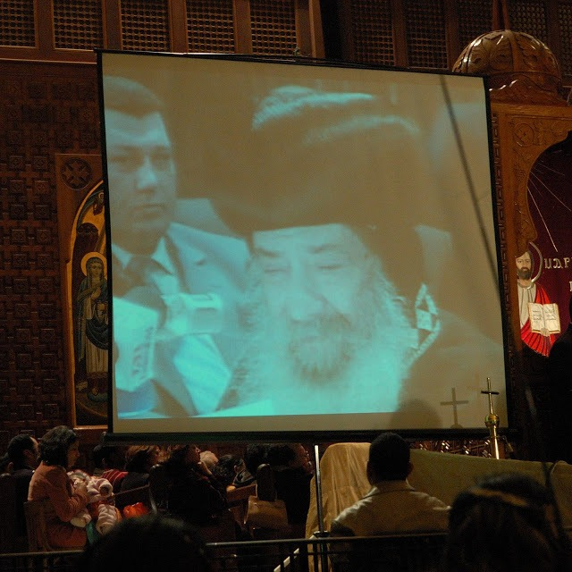 TV screen showing Pope Shenouda III