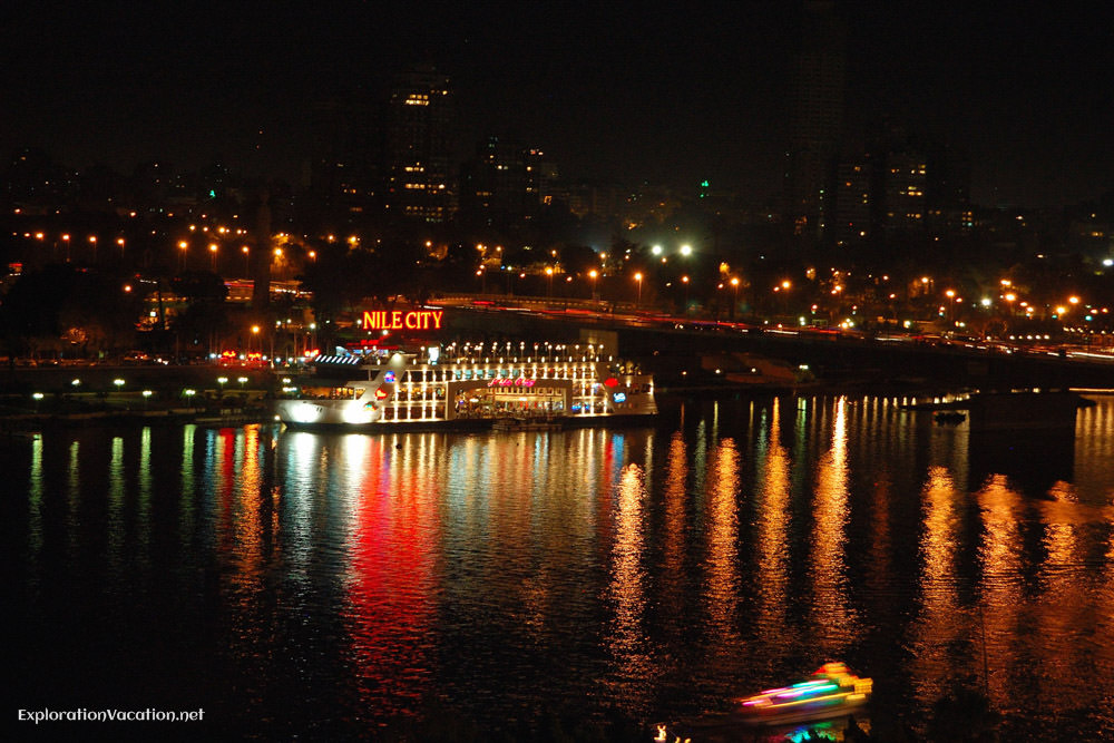 night view with river boat and colored lights