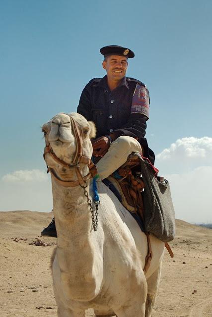 police officer on a camel