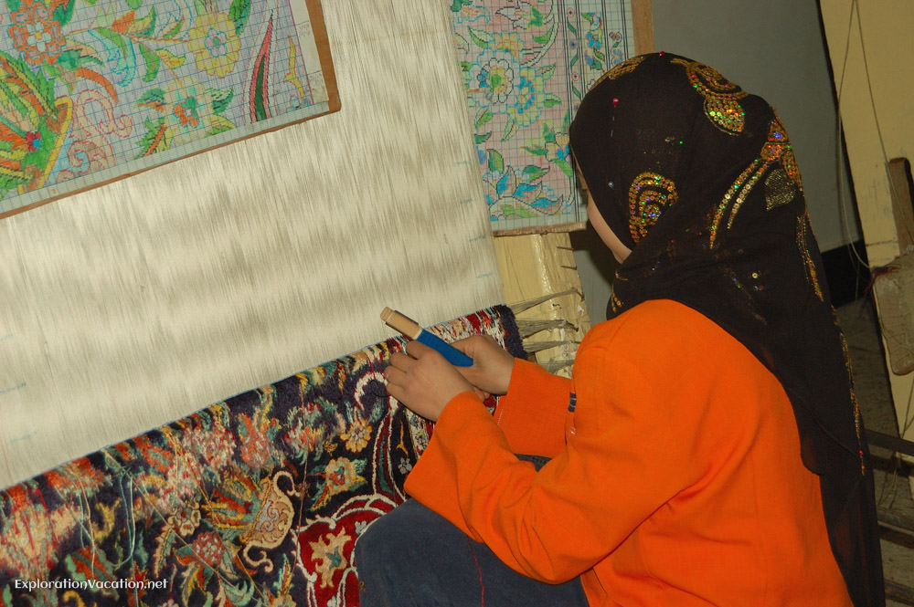woman weaving carpets