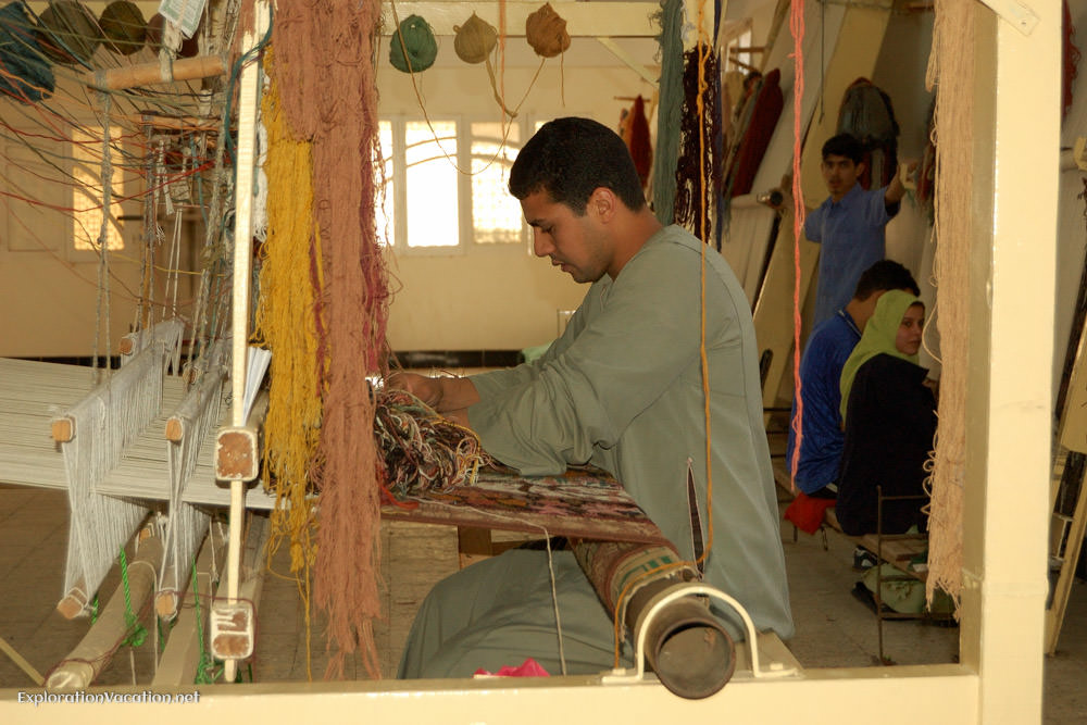 man weaving carpets
