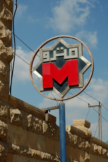 red m sign