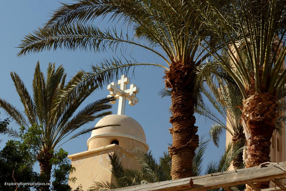 cross with palm trees