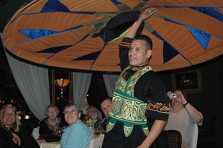dancer twirling fabric above his head
