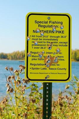 fishing regulation sign with gunshots