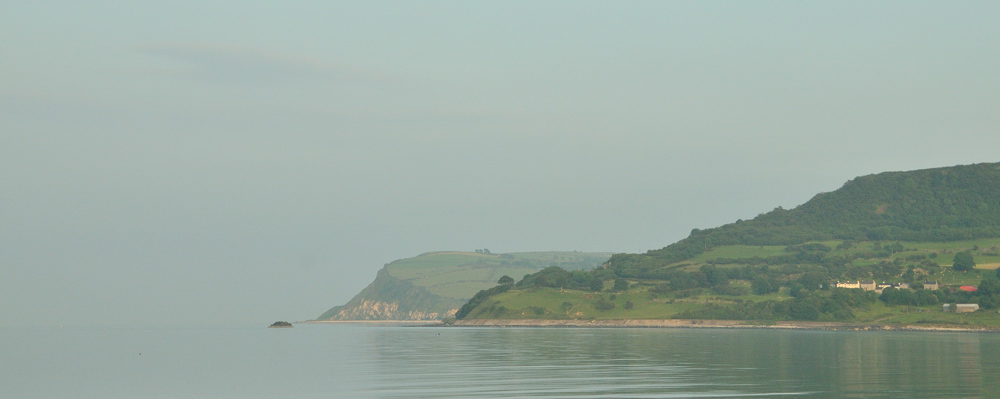 distant cliffs along the shore