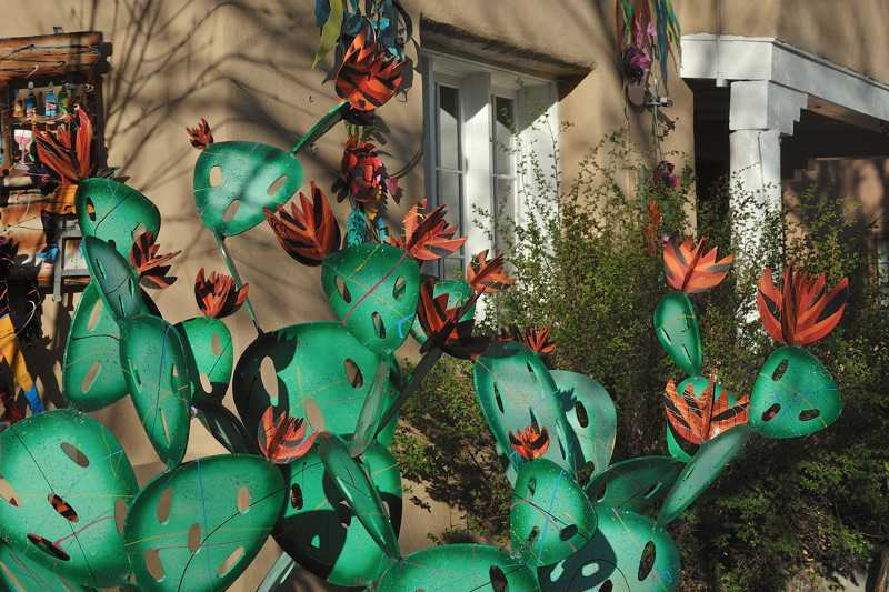 Metal sculpture of prickly pear cacti in bloom