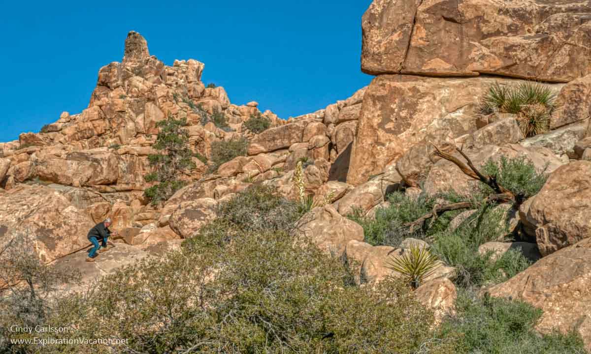 Man on rocks in desert landscape