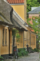 Bikes along the street on a quiet morning in Dragor, Denmark - ExplorationVacation