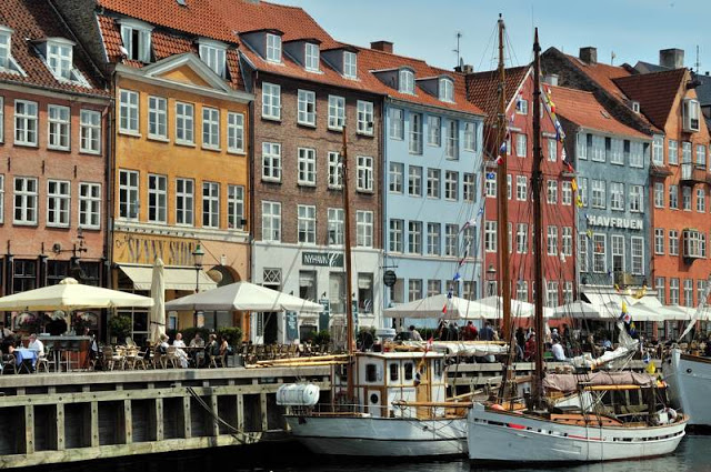 Along the water in Nyhavn, Copenhagen, Denmark - ExplorationVacation.net
