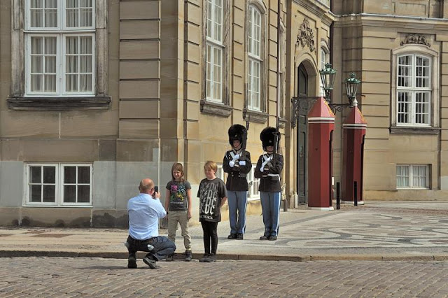 Posing for pictures with the Royal Danish Life Guards at Amalienborg Slot royal palace in Copenhagen, Denmark - ExplorationVacation.net 6-DSC_2353