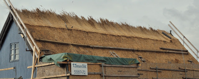thatch roof being installed