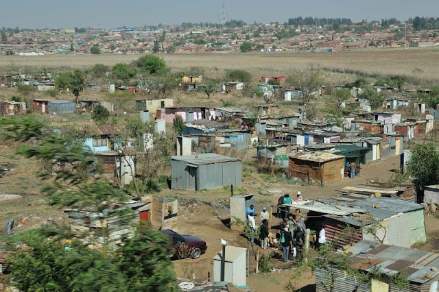 A poor neighborhood in Soweto, South Africa, - ExplorationVacation.net