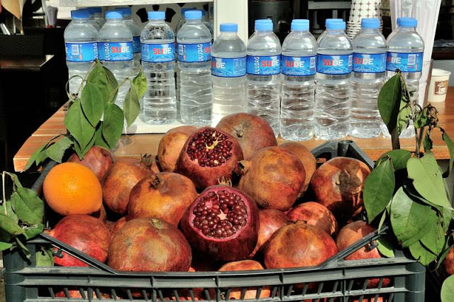 pomegranates and water bottles