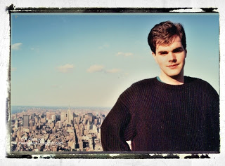 Young man with city behind him