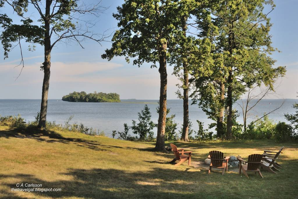 yard with picnic area and lake with an island in the backround
