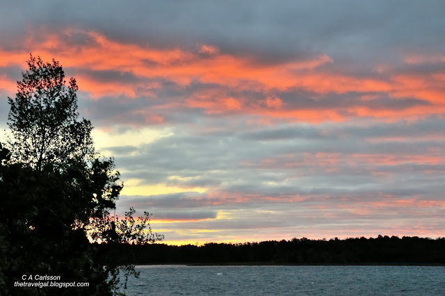 red clouds over lake