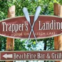 Trapper's Landing sign with canoe paddles