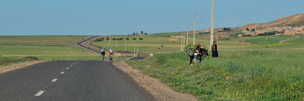 bikes and field workers along the road in Morocco