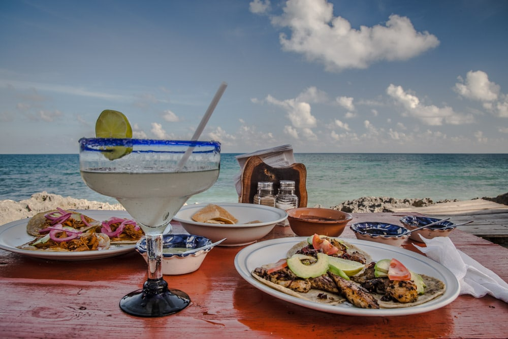 Lunch and a big drink above the ocean in Tulum Mexico