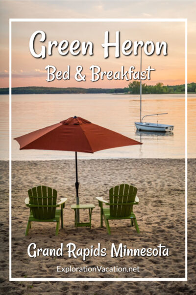 """sunset on a beach with chairs and umbrella and text """"Green Heron B&B Grand Rapids MN"""""""