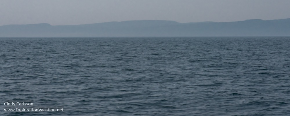 open water with hazy hills in the distance