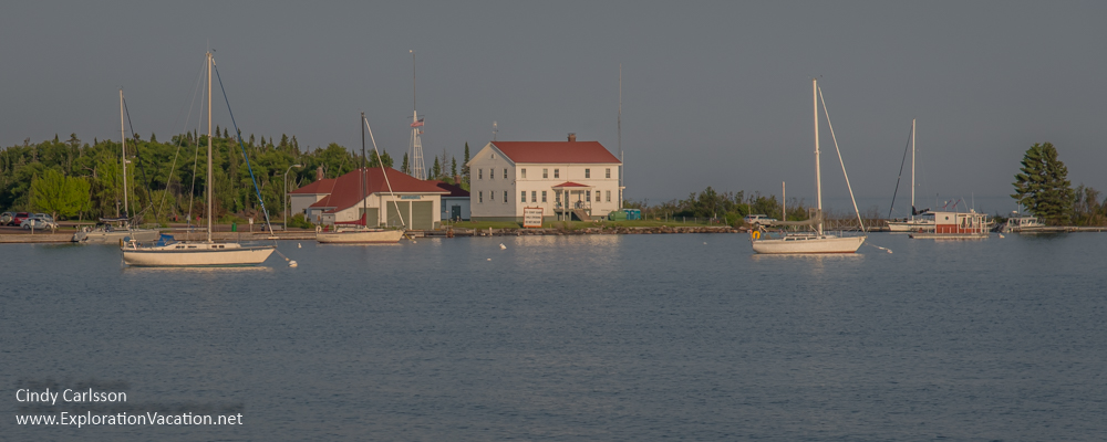harbor with historic buildings and small sailboats
