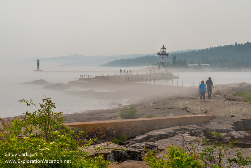walkways, and lighthouse with people and fog