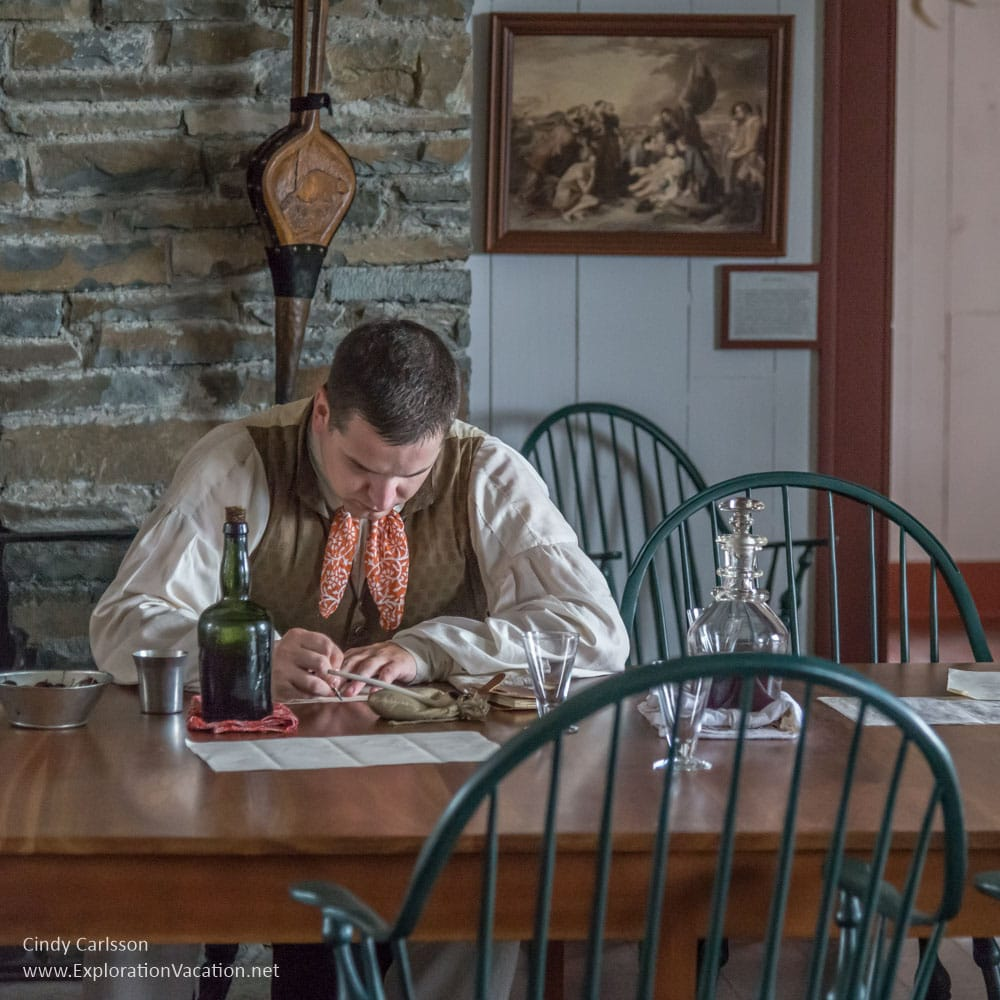 Man at work in the Great Hall at Grand Portage Monument