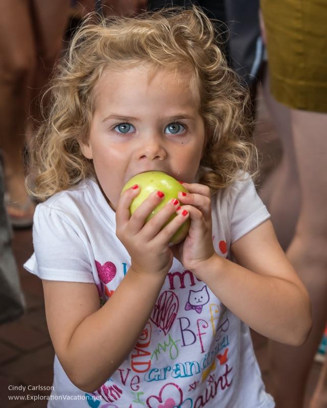 girl with apple Saint Paul farmers market