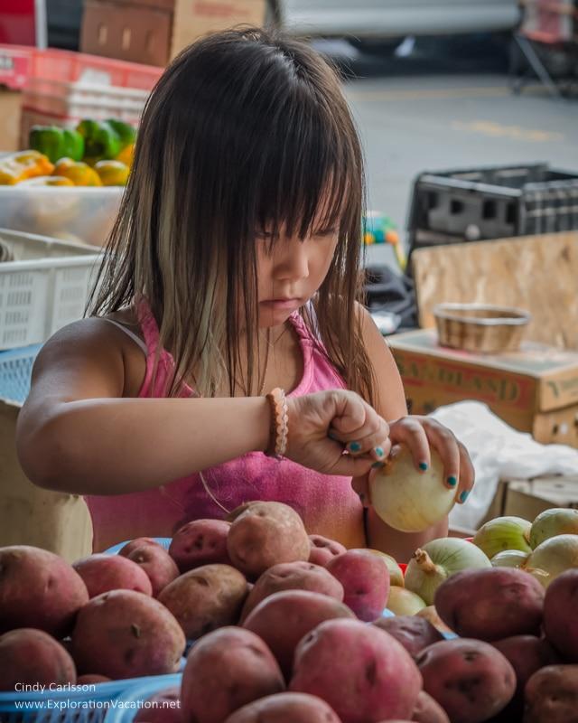 girl with onion Saint Paul farmers market