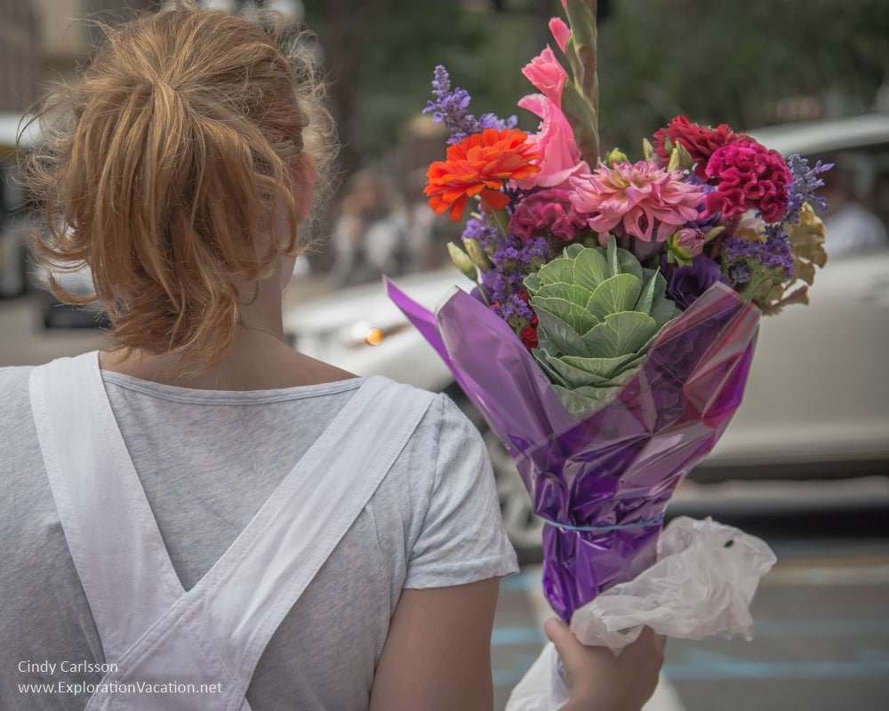 leaving with flowers at the Saint Paul farmers market Minnesota