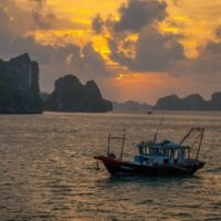 Halong Bay sunrise with fishing boat