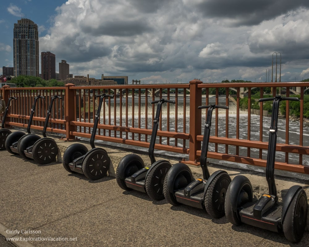 Crossing the Stone Arch Bridge (with time for photos) on a Segway tour of the historic Mill District in Minneapolis, Minnesota - ExplorationVacation