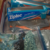 Suitcase packed using Zip lock bags - ExplorationVacation.net