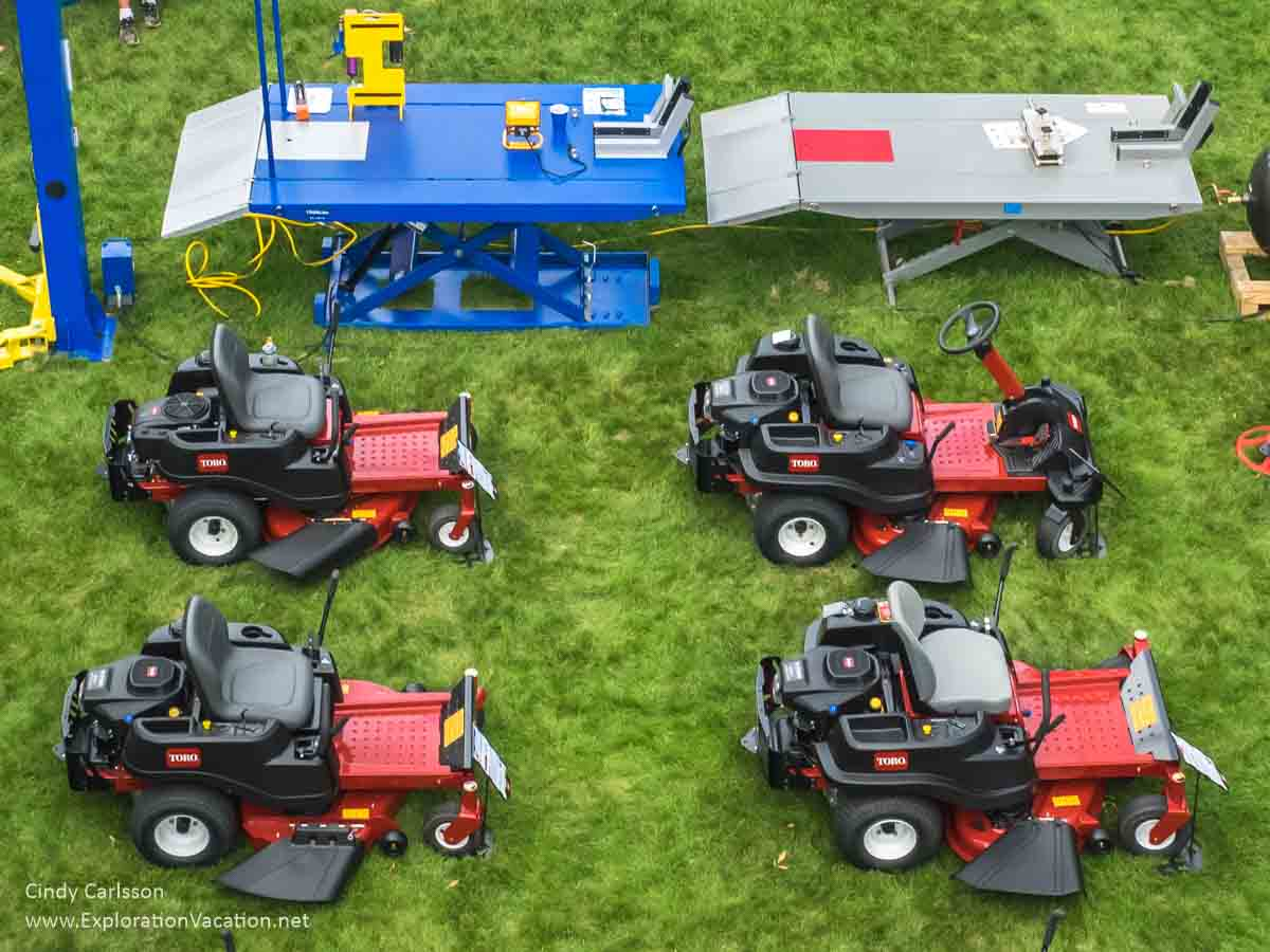 Four garden tractors and two trailers seen from above