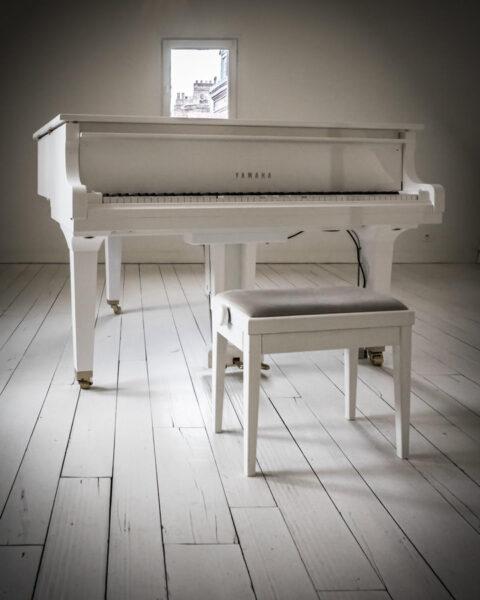 white piano in a white room