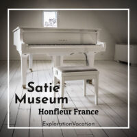 "white piano in a white room with text ""Satie Museum Honfleur France"""