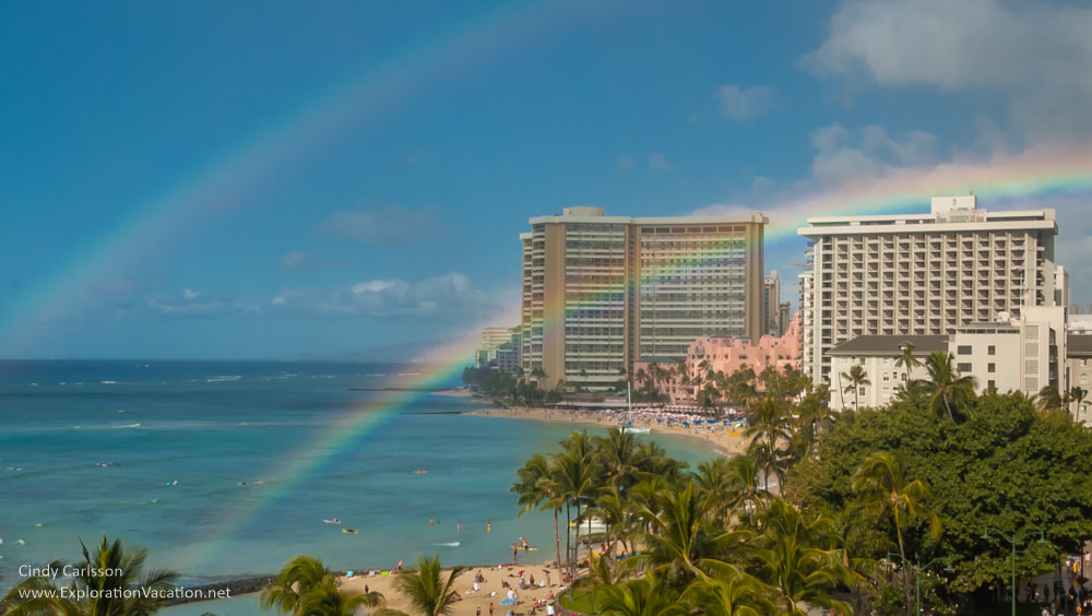 Photo of Waikiki Beach with rainbows by ExplorationVacation.net