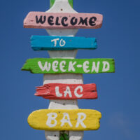Sign for the Week-End Lac Bar near the beach on Lac Bay in Bonaire - ExplorationVacation.net