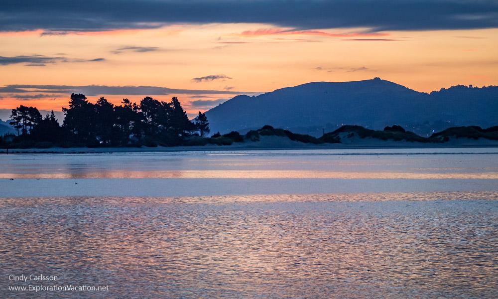 Sunset at Pilots Beach on New Zealand's Otago Peninsula - ExplorationVacation.net